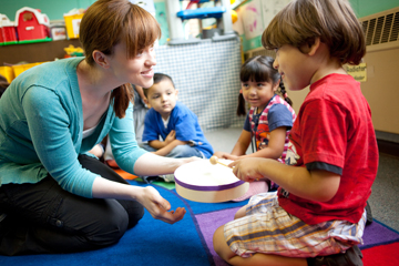 Amanda Whiteman with child in classroom