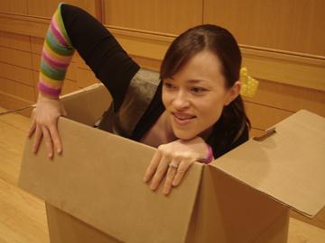 Amanda Whiteman climbing out of a box