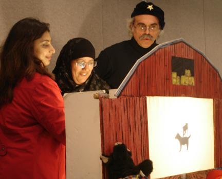 Joe Pipik does shadow puppets with teachers