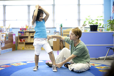 Laura Schandelmeier works with a child on straight lines in a classroom