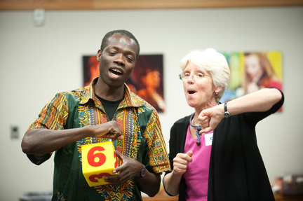 Sue Trainor and Kofi Dennis sing together