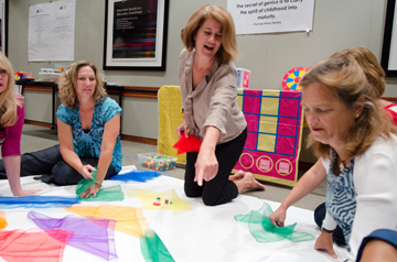 Val Carroll works with preschool teachers in a training session
