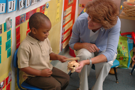 Val Carroll and child in classroom