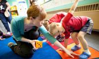 Amanda Whiteman helps a child make a body shape