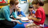 Amanda Whiteman with child in classroom