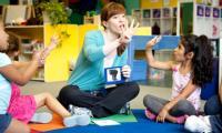 Amanda Whiteman with children in a classroom