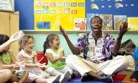 Kofi Dennis does a call and response with children