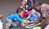 Kofi Dennis with babies in BAP class
