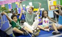 Laura Schandelmeier in a classroom with children, using string to explore shapes