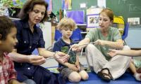 Laura Schandelmeier with children and teacher in classroom