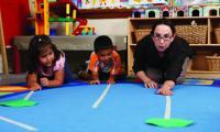 Rachel Knudson with children in classroom