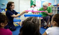 Sue Trainor demonstrates a music experience with a teacher for children in a classroom