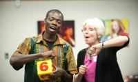 Sue Trainor and Kofi Dennis sing together